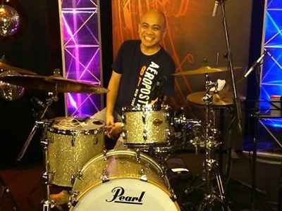 Drummer smiling in a stage setting